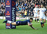 Huw Jones scores a try against England in Calcutta Cup match