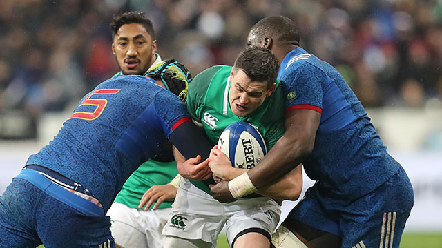 Johnny Sexton is tackled during the France v Ireland match in 2018 Six Nations
